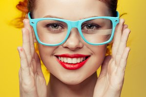 Bright woman in glasses smiling