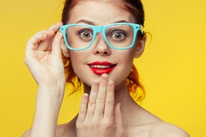 woman in glasses surprised