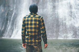 Man looking at waterfall Travel