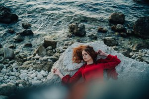 Woman red dress at the sea