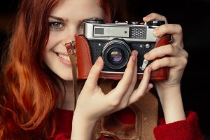 redheaded girl photographer smille