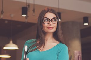 Woman-freelancer with glasses