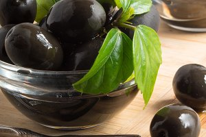 Black olives in a glass bowls