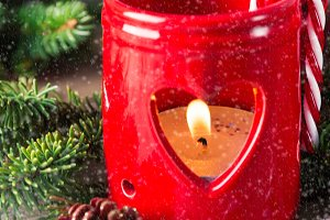 Red Christmas candle on wooden background