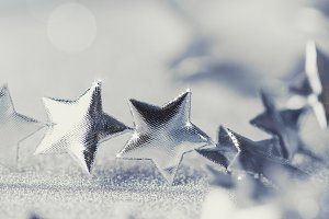 Christmas silver stars on sparkling background