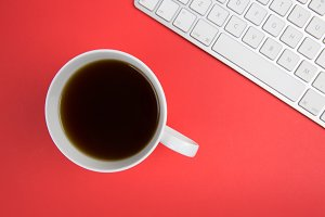 Coffee + Keyboard on Red Background