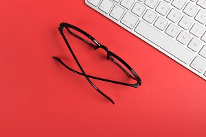 Glasses + Computer on Red Background