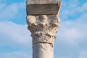 Greek column on the blue sky