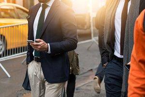 businessman use smartphone on street
