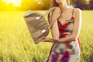 Fashionable girl with a bag