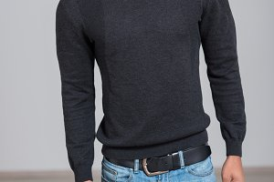 casual man wearing black sweater