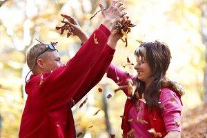 Couple enjoying the falling leaves