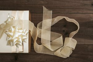 gift box with ribbon on wood vintage