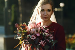Autumn bride in a red jacket