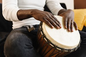 Artist playing the drum.