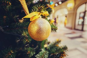 Christmas tree decoration in golden light closeup for background. New year fir branch photography