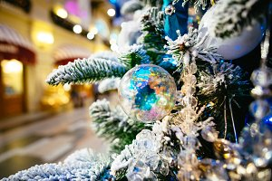 Christmas tree decoration closeup for background. New year firtree branch in snow photography
