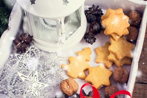 White box with Christmas decorations and homemade cookies. Tinte