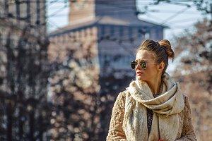 tourist woman near Sforza Castle in Milan, Italy looking aside
