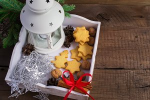 Box with homemade cookies, cinnamon and Christmas decor