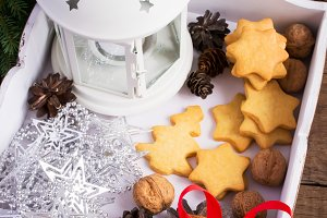 White box with Christmas decorations and homemade cookies