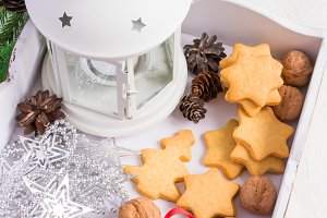 White wooden box with homemade cookies and Christmas decorations