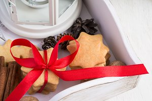 Christmas cookies tied with red ribbon in a wooden box