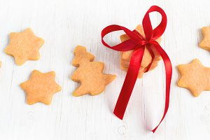 Cookies in the form of stars laid out on a white background, a r