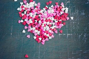 Valentine's day background with a heart of colored hearts. Tinte