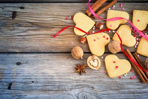 Cookies in the shape of hearts, colorful hearts, ribbons, cinnam