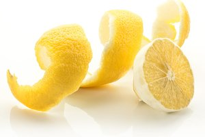 Twist of citrus peel on a white background.