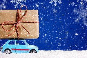 Retro toy car with christmas gifts