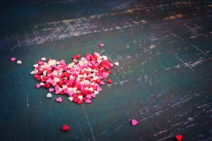 Valentines day colorful hearts on a dark shabby background. Tint