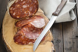 Spanish sausage called morcon on a cutting board