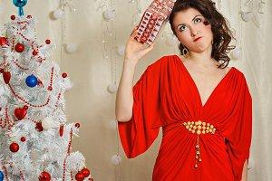 Girl in red dress. Christmas gift