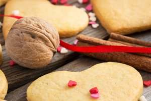 Valentine cookies on a background of colorful sweet hearts, ribb
