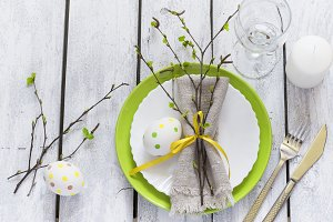 Spring Easter Table setting at white wooden table. Top view.