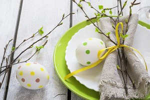 Spring Easter Table setting at white wooden table.