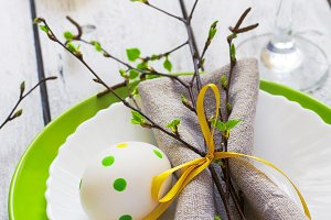 Spring Easter Table setting at white wooden table with boards