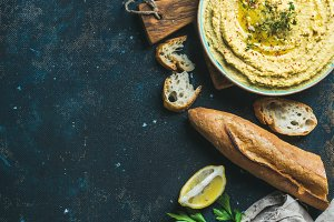 Homemade hummus dip with baguette