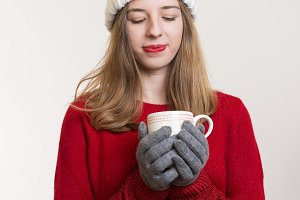 Woman holding a hot Cup of Tea