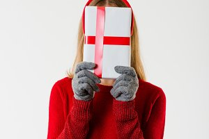 Woman covering her Face with a Gift