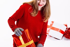 Woman opening her new Gifts