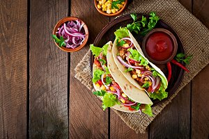 Mexican tacos with meat, vegetables