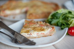 open pie with salmon, spinach and dill.