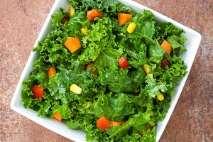 Kale salad on rusty background