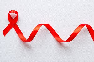 red ribbon symbol of World AIDS Day
