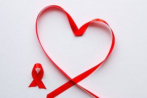 red ribbon in the shape of a heart
