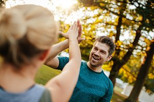 Fit young man giving high five