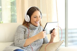 Girl listening music with tablet